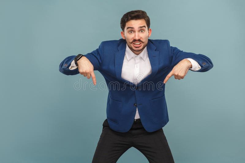 Now, looking down! Man pointing at copy space royalty free stock photos
