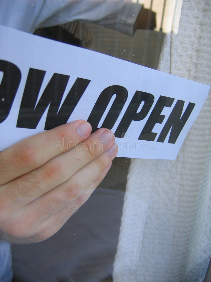 Now Open. A store just opening for business stock photos