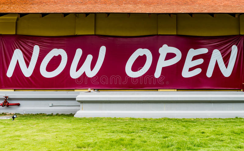 Now open sign. Now open text sign on concrete wall royalty free stock photography
