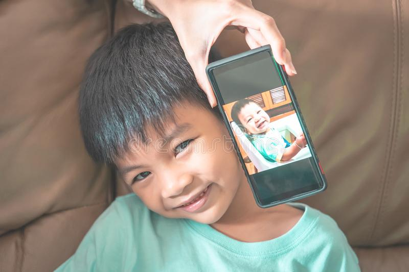 Now and boy comparing picture with his baby time royalty free stock images