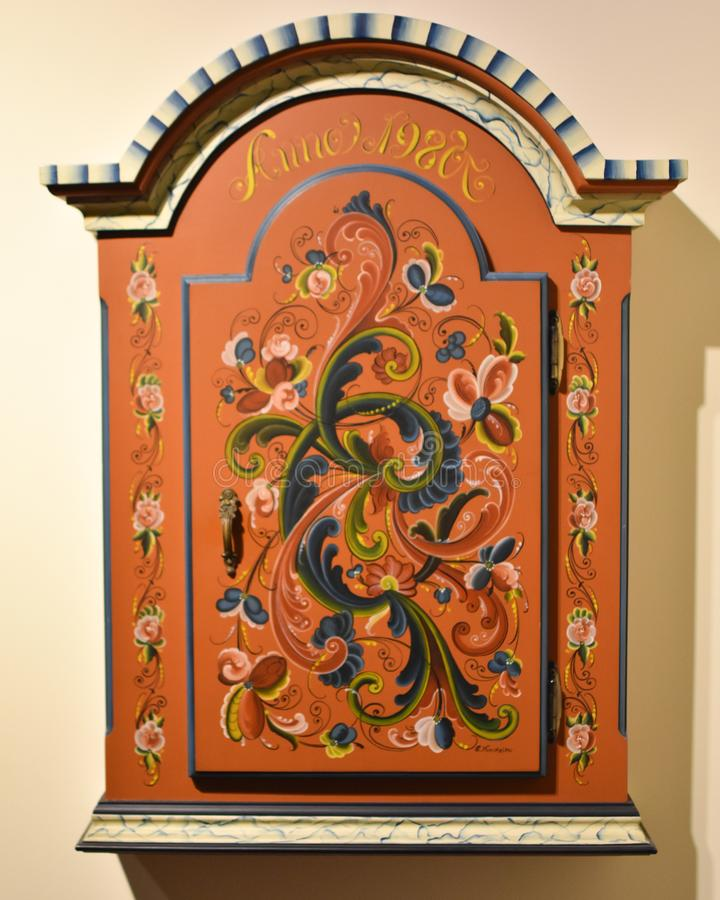 Norwegian Wall Cabinet with Rosemaling stock photography