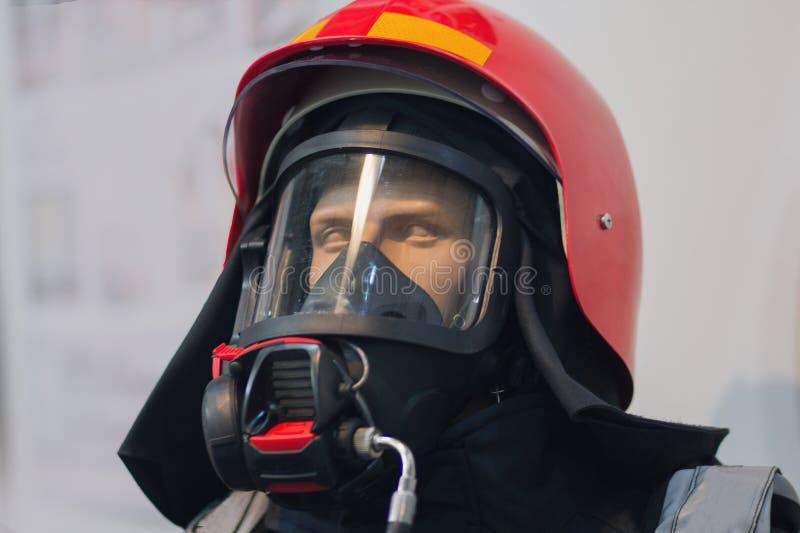 Nowożytny palacza hełm i ochronna odzież zdjęcia royalty free