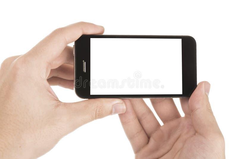 Nowożytny smartphone w ręce odizolowywającej na bielu fotografia royalty free