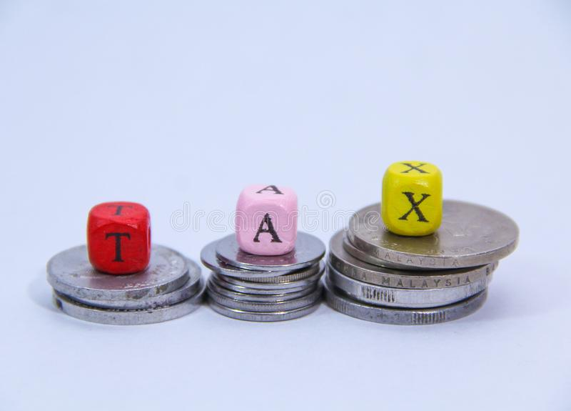 Tax alphabet concept with stack coin stock images