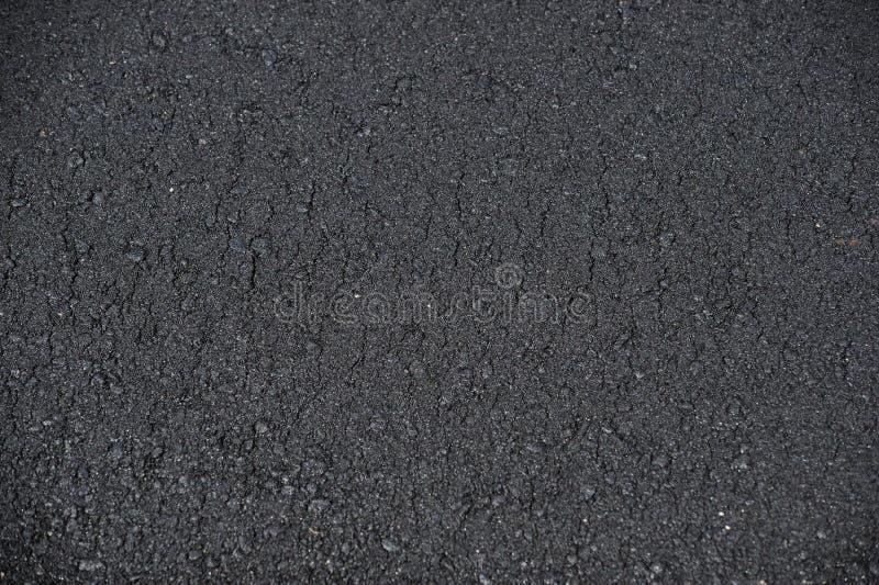 Nowy brukujący drogowej powierzchni asfaltu tło obrazy royalty free