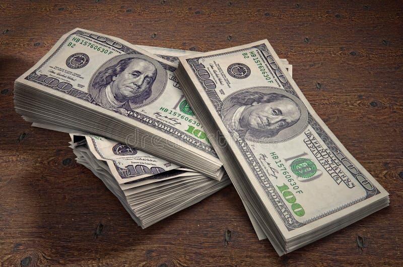 Nowy Jork Stany Zjednoczone, Lipiec, - 5, 2018: Sterty Sto USA dolarów na drewnianym tle Wysokiej jakości ilustracja 3D ilustracja wektor