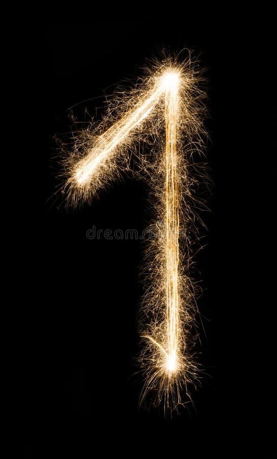 Nowy rok chrzcielnicy sparkler liczba jeden na czarnym tle fotografia royalty free
