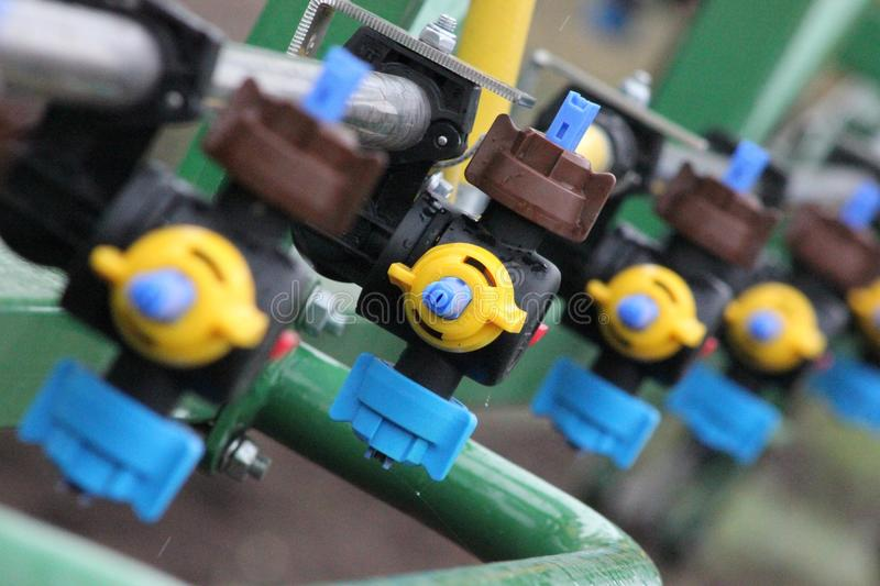 Nozzles. That installed onto boom of sprayer stock image