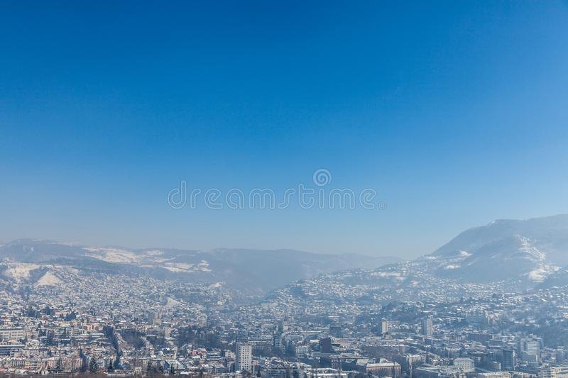 Aerial view of Sarajevo during a sunny winter afternoon, covered in snow. NPicture of Sarajevo seen from above during a sunny winter day covered in snow stock photo