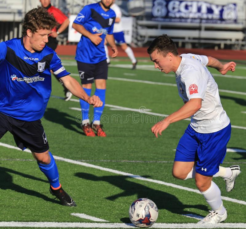 NPSL soccer game. Defended stands in front of the midfielder at the professional Soccer event, pro football game, NPSL, National Premier Soccer League, AFC stock photo