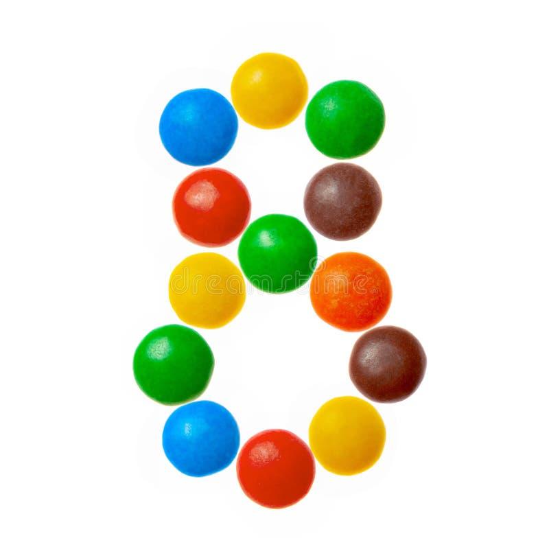Nr. 8 acht von den süßen farbigen Süßigkeiten, Alphabet lokalisiert auf weißem Hintergrund lizenzfreie stockfotografie