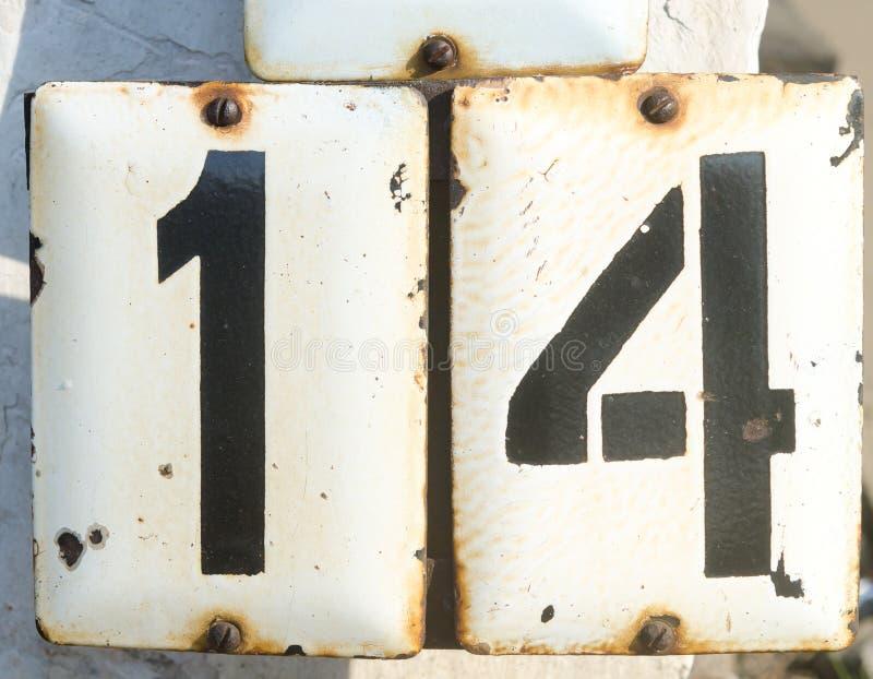 Nr. vierzehn auf der metall Platte lizenzfreies stockfoto