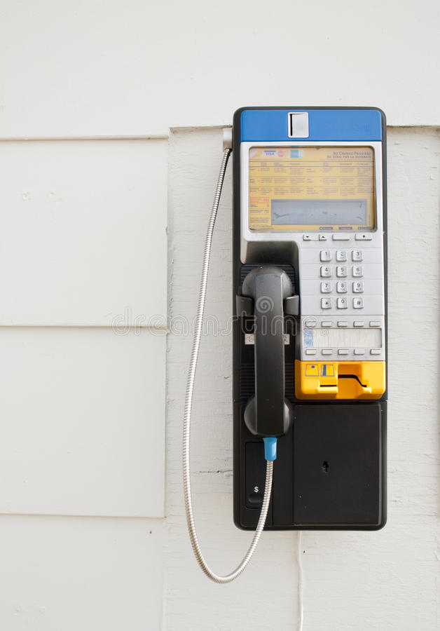 Nrthern Telecom Payphone. Debert, Canada - August 31, 2014: Northern Telecom payphone. Nortel Networks Corporation, formerly known as Northern Telecom Limited royalty free stock photography