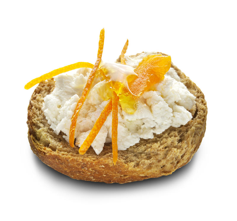 Ntakos with soft white cheese and orange sweet stock images