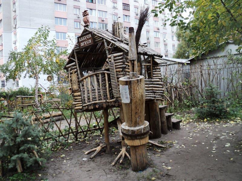 nteresting wooden sculpture hut on chicken legs on the playground called `Good fairy tale` stock photo