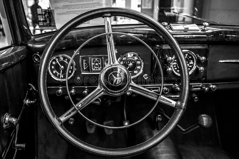 Nterior of a full-size luxury car Mercedes-Benz 220 `Cabriolet A` W187, 1951. BERLIN - MAY 06, 2018: Interior of a full-size luxury car Mercedes-Benz 220 ` stock photos