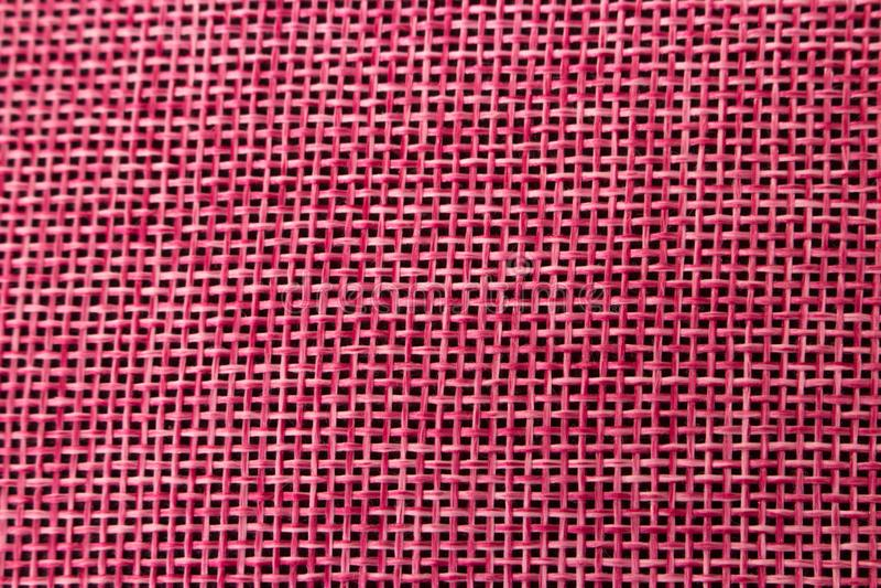The texture of the fabric. Fuchsia color. Close-up texture. NThe texture of the fabric. Fuchsia color stock image