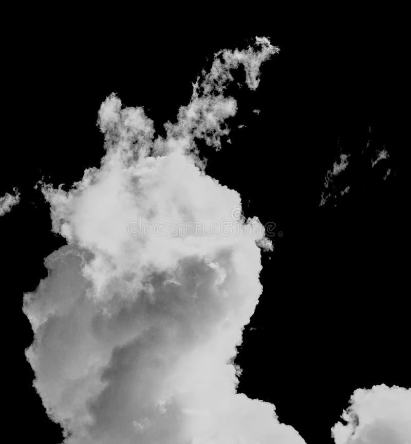 Nuage blanc pelucheux contre un ciel noir image libre de droits