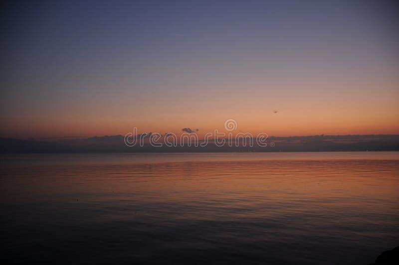 Nuage de ciel d'ombre de mer de lever de soleil photo stock