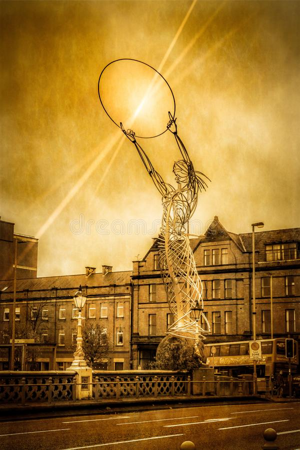 Nuala with the Hoola, Belfast, Northern Ireland. Nuala with the Hoolahoop is a famous piece of modern art and sculpture erected in Thanksgiving Square, Belfast royalty free stock image