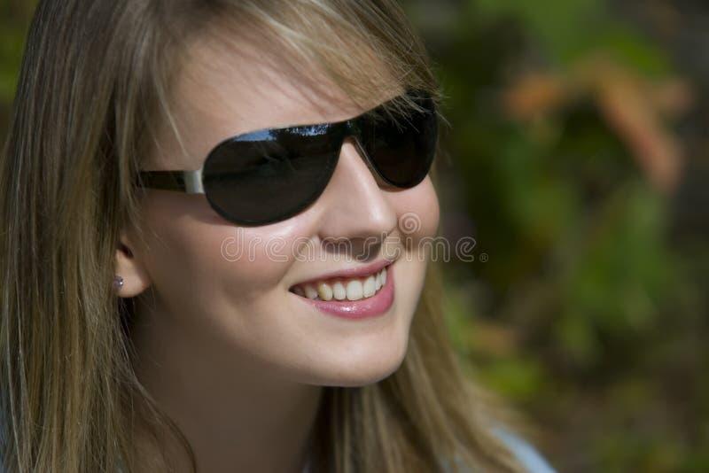 Nuances et un grand sourire photo stock