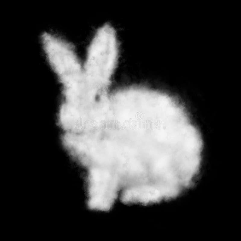 Nube blanca en la forma de un conejo aislado en un fondo negro imagenes de archivo