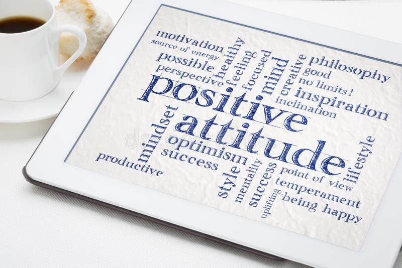 Nube de la palabra de la actitud positiva en la tableta imagenes de archivo