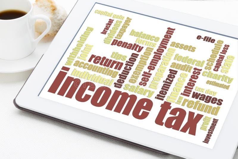 Nube de la palabra del impuesto sobre la renta fotografía de archivo