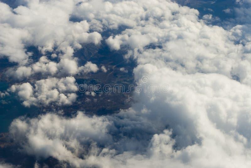 Nube, sol, plano imagen de archivo