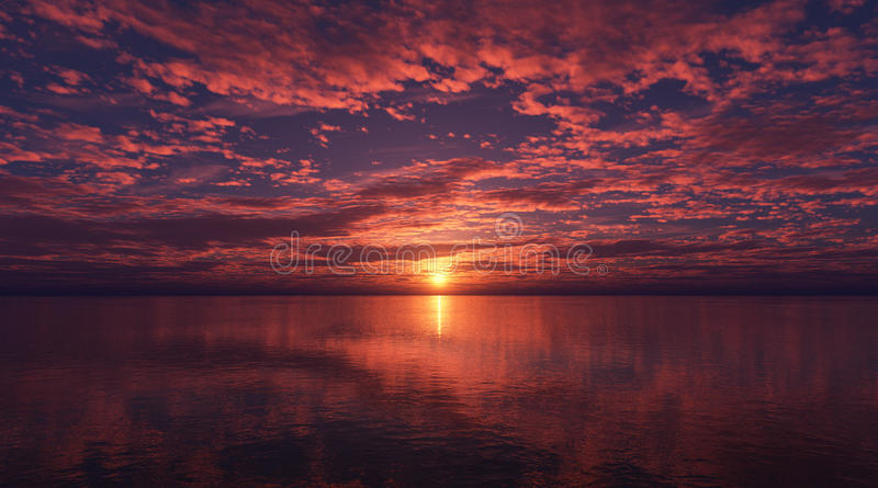 Nubes sobre el mar en la puesta del sol foto de archivo libre de regalías