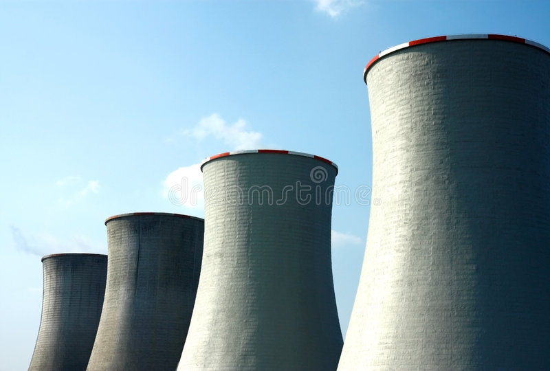 Nuclear cooling towers. Four nuclear cooling towers under sky stock photography