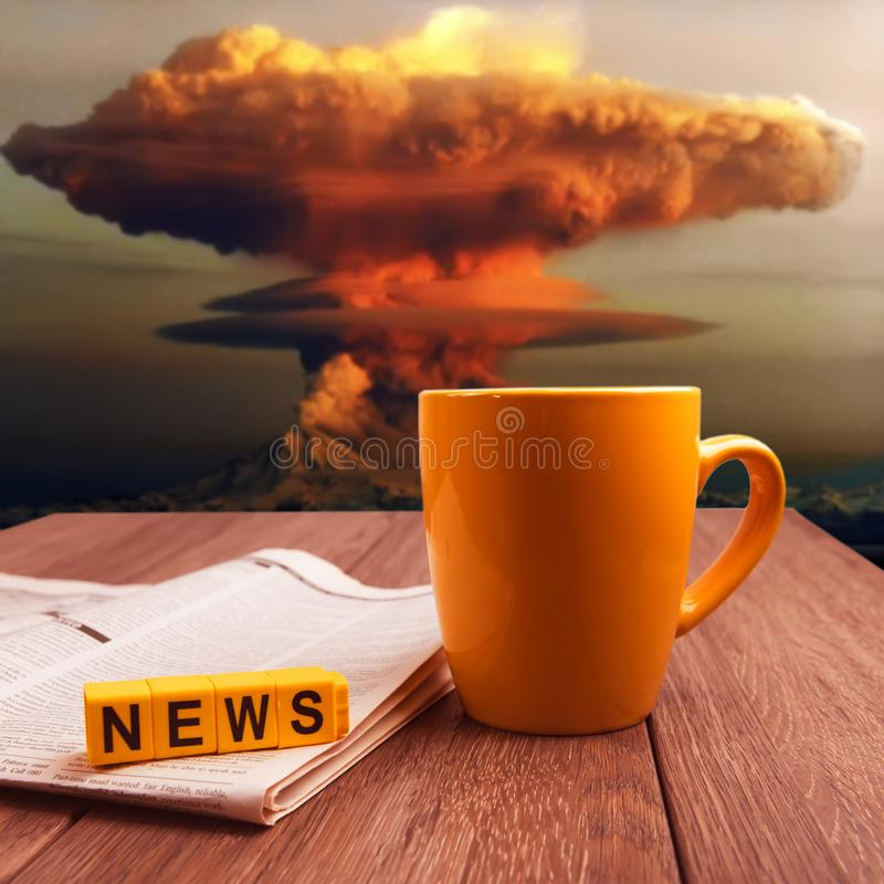 Nuclear explosion news. News about  nuclear bomb explosion collage image. Mug of coffee and newspaper on wooden table at nuke time royalty free stock photos