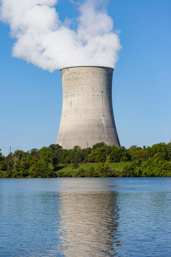 Nuclear Plant Cooling Tower. Reflection of a nuclear plant cooling tower in a river stock images