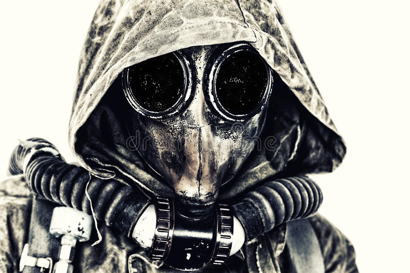 Nuclear post apocalypse. Studio shot of survivor in tatters and gas mask royalty free stock photo