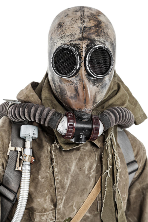 Nuclear post apocalypse. Studio shot of survivor in tatters and gas mask royalty free stock photography