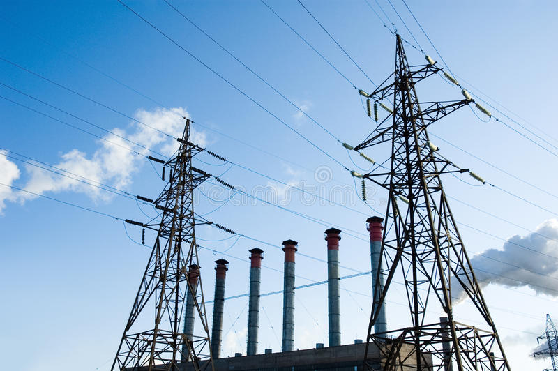Nuclear power. Image of nuclear power towers with wires in the background of blue sky royalty free stock photography