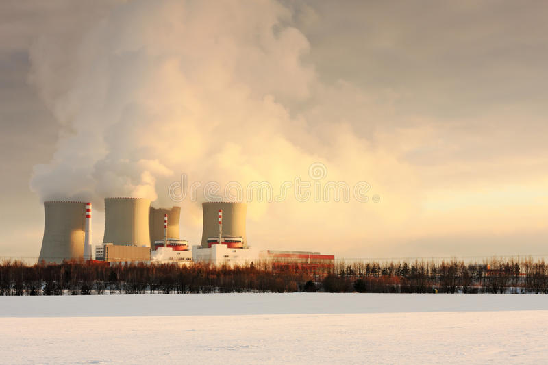 Nuclear power plant. Image of smoking nuclear power plant in winter stock photos