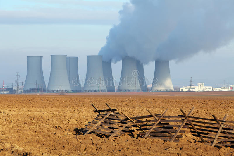 Nuclear power plant. And field royalty free stock photos