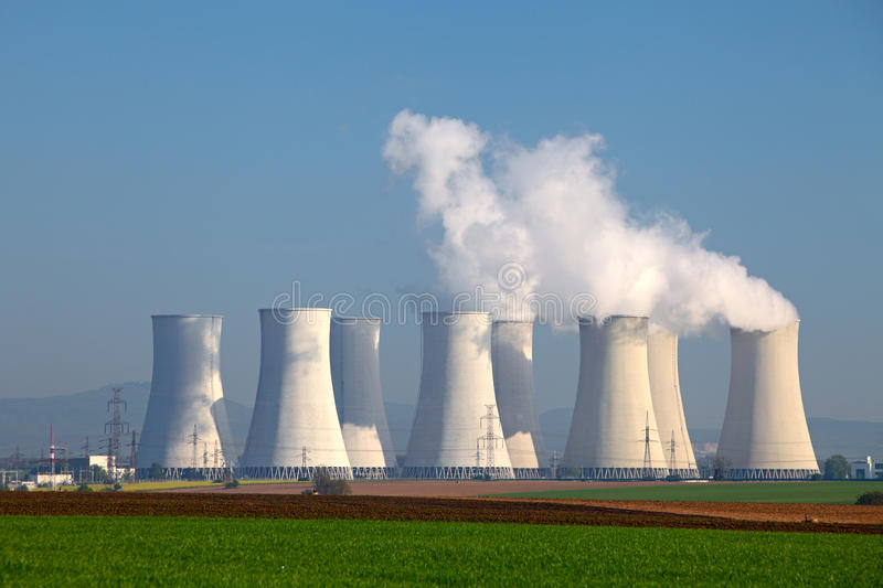 Nuclear power plant. Nuclear power plant with green meadow stock photo