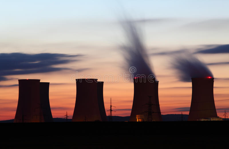Nuclear power plant. By sunset stock image