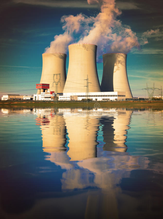 Nuclear power plant. Nuclear power plant on the coast. Ecology disaster concept stock photography
