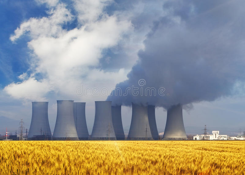Nuclear power plant. With yellow field stock image