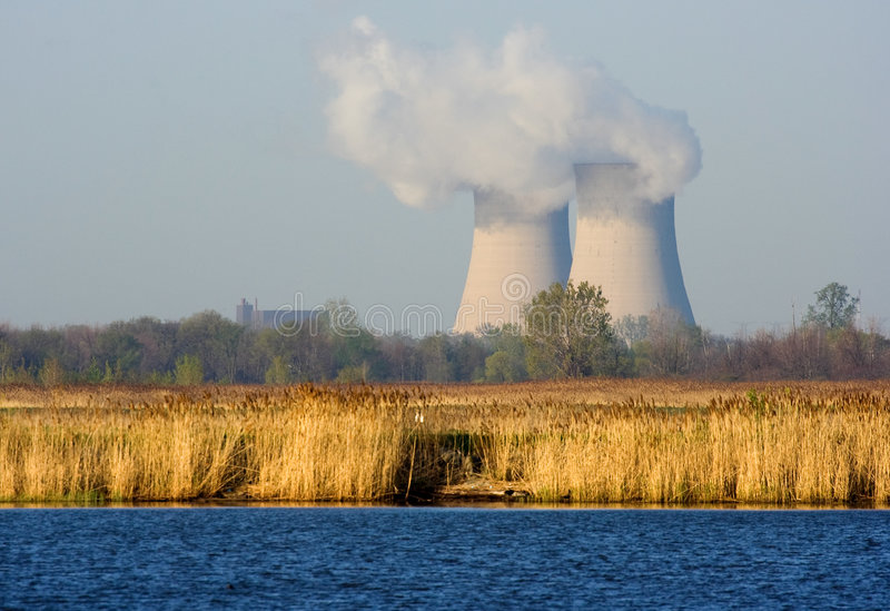 Nuclear Power Plant. Nuclear Powered Electric Power Plant and Cooling Towers royalty free stock images