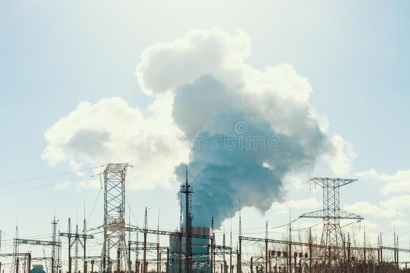 Nuclear Power Plant Chimney tower with smoke or vapor, power industry concept. Toned royalty free stock images