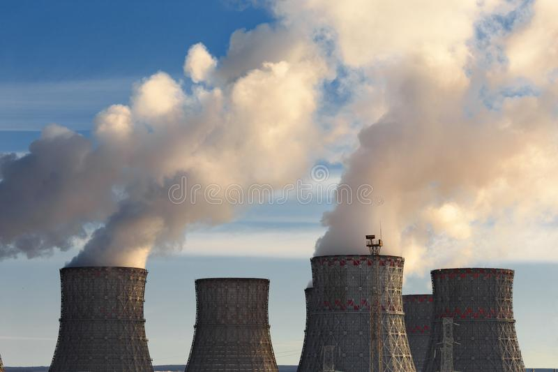 Nuclear Power Plant, clouds of thick smoke from cooling towers or chimneys, atomic nuclear energy concept. Toned stock image