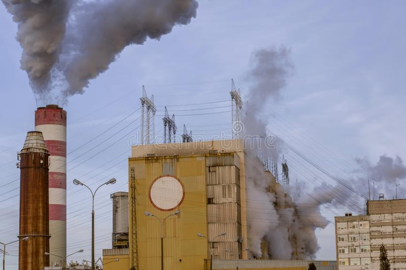 Nuclear power plant discharges steam into the atmosphere. Cooling its reactors royalty free stock image