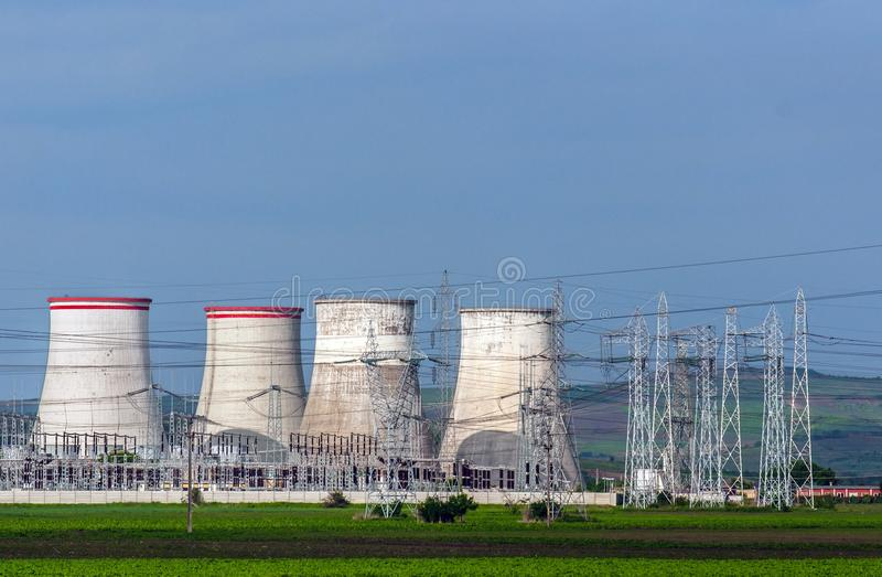 Nuclear Power Plant With Electric Pylons Royalty Free Stock Photo