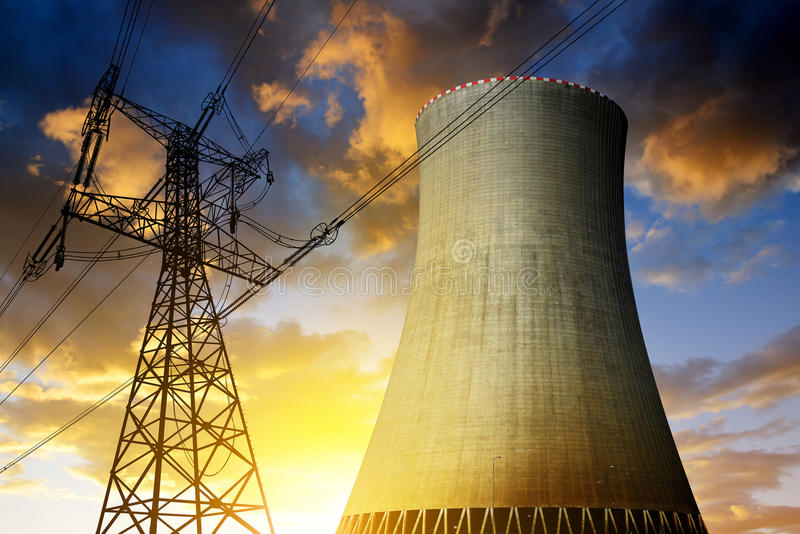 Nuclear power plant with high voltage towers stock photography
