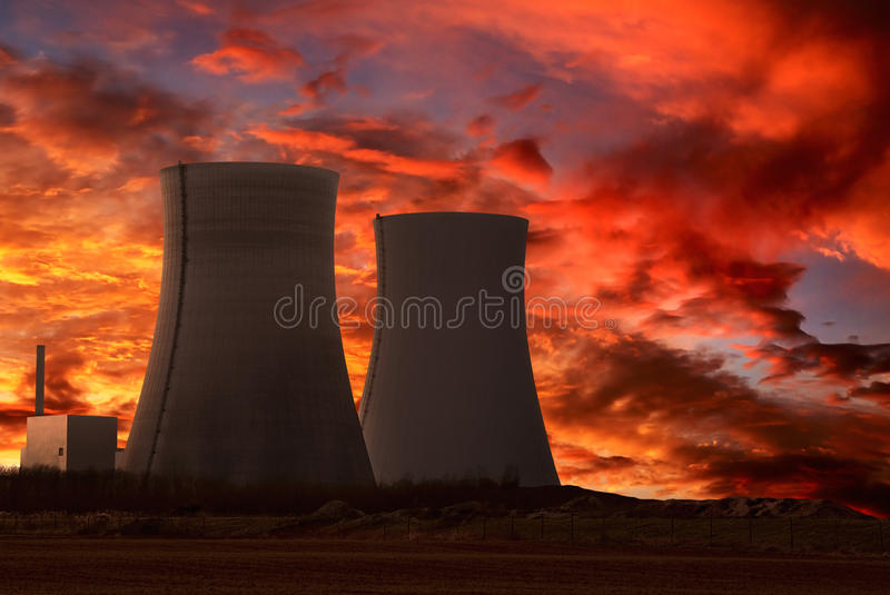 Nuclear power plant with an intense red sky. Nuclear power plant with an intense red and cloudy evening sky stock images