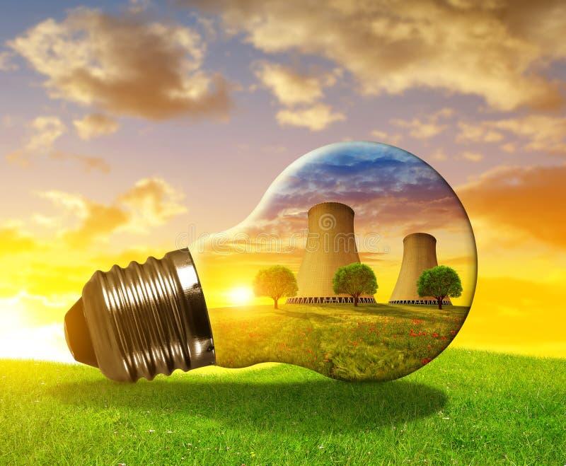 Nuclear power plant in light bulb. Nuclear power plant in light bulb at sunset stock photo